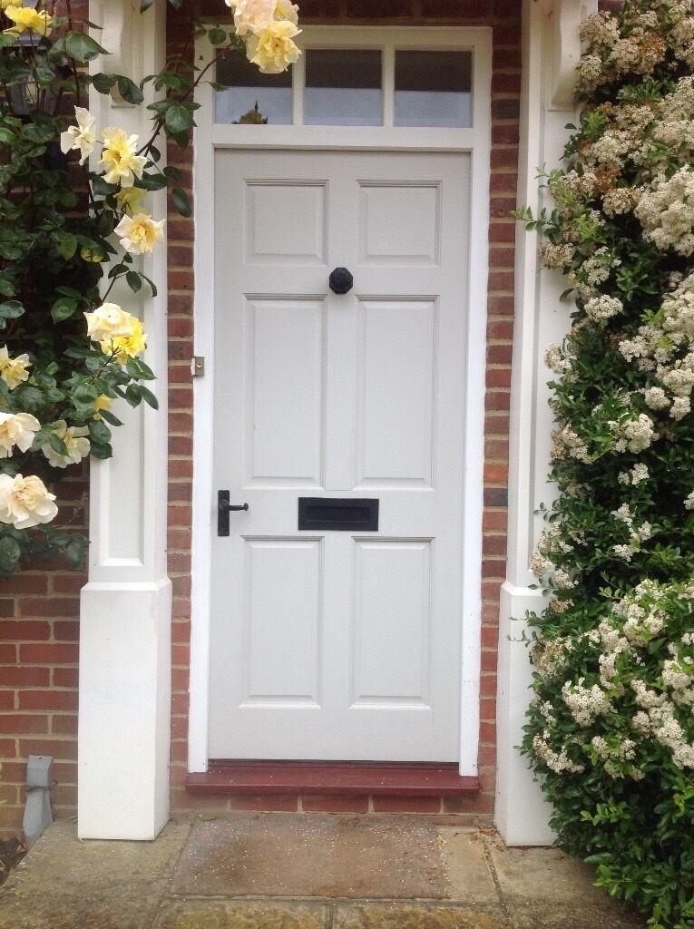 Wooden Front Door With Black Door Furniture In