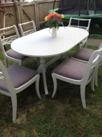 Light grey extending dining table and 6 chairs