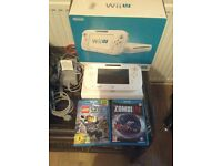 Nintendo wii u white 8gb with two games