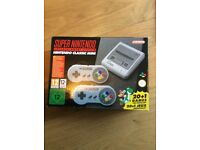Super snes mini with extra 100 games +