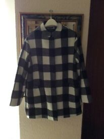 Ladies Coat size 12to14es New York.Black and cream squares.Four large buttons ,Two large pockets