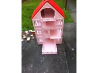 Wooden Dolls House In Really Good Condition - Painted Pink & Red With Some Furniture.
