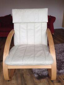 Cream leather armchairs