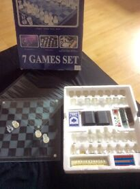 Chess set glass and 6 other games.