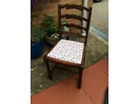 Solid wooden chair in good condition with lovely padded seat
