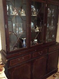 Glass cabinet with drawers and cupboards below