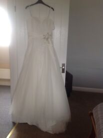 Wedding dress used once ,but has been cleaned