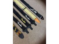 6 Guitar straps 5 Fender and 1 Gibson
