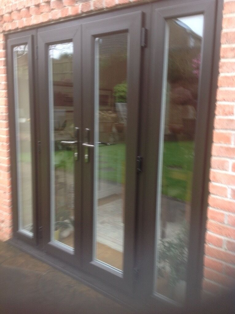 Evolution storm upvc timber effect french doors with side for Doors with panels