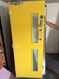 Glazed Internal fire door Approx. 1990mm x 760mm. Comes with fixtures seen in photo. Good condition.
