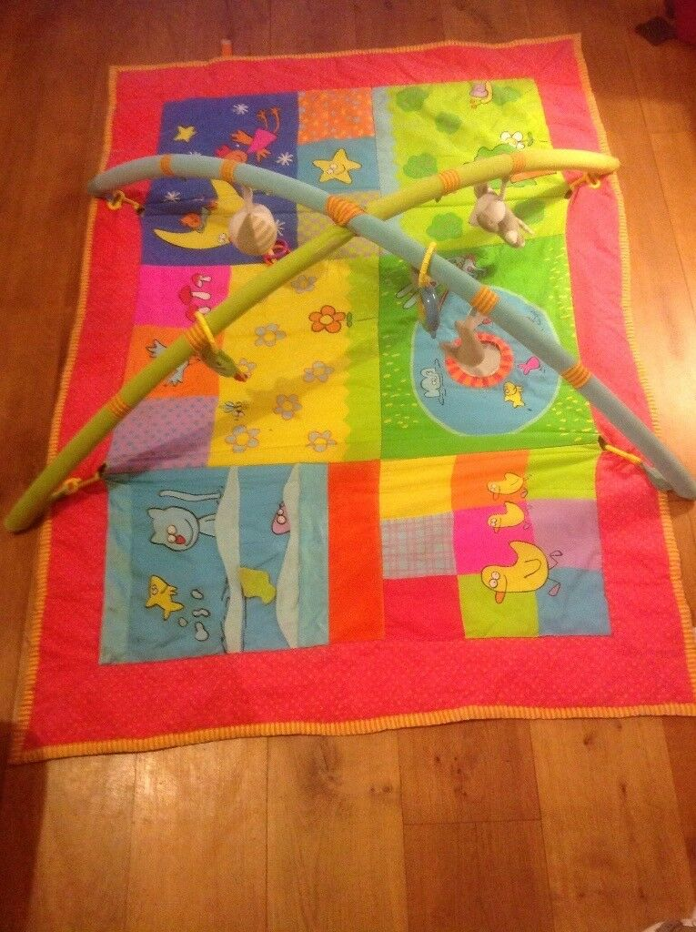 large activity mat with detachable toys