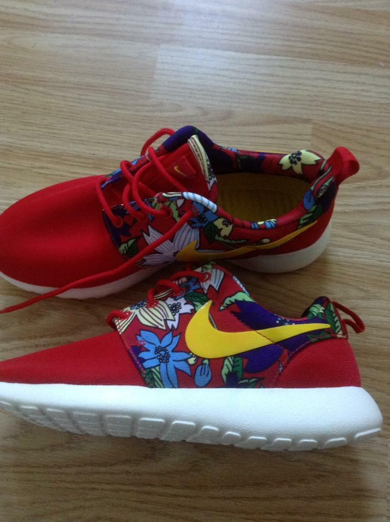 New ladies red Nike trainers