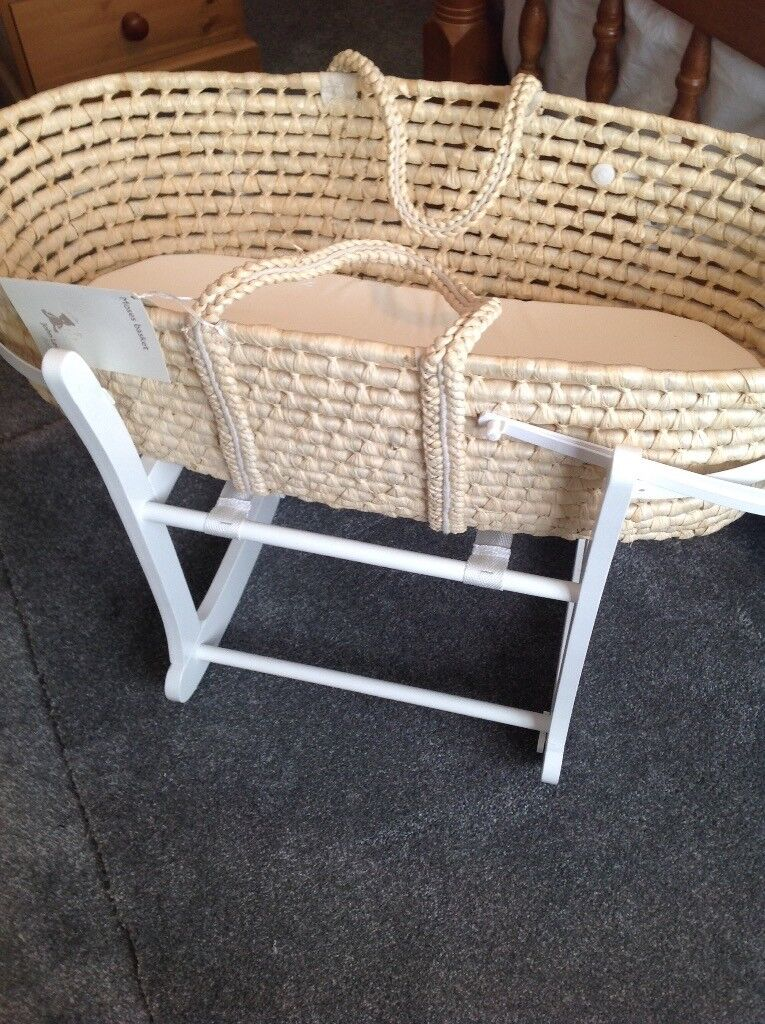 Moses basket with stand . Cot with wheels