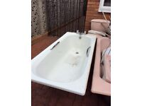White bath with tapes and toilet