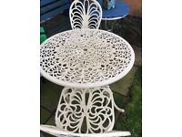 cast aluminium table and 4 chairs can be taken apart for transporting good con may need painting