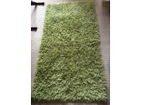 Green rug from next