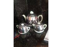 Beautiful tea pot set with silver cover. Duck egg blue/green colour.