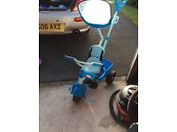 Blue child's trike with parent handle