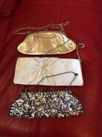 3 smart handbags,gold,white and sequinned.