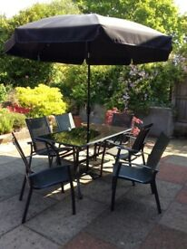 Table, six chairs and sun umbrella