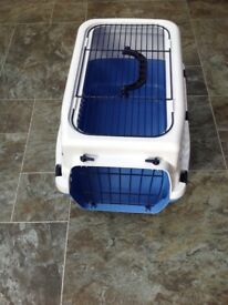 Plastic grey and blue cat carrier