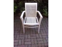 8 solid wood garden chairs, painted cream.