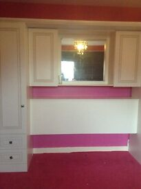 Over bed unit with wardrobes