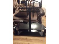 Black glass Tv stand with brackets
