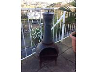 Cast iron chimenea with BBQ grill and chimney lid