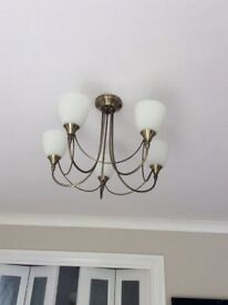 Two five arm up lighting ceiling lights with white shades
