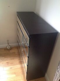 Solid wood chest of 10 drawers with mirrored front.