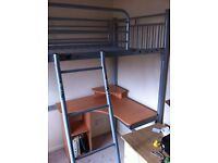Metal cabin bed without matress, nice desk underneath.