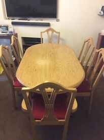 Lime Oak dining room Oval dining table with two Carver chairs and 4 side chairs. Very solid.