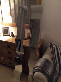 Two IKEA swirly wall mirrors
