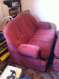 Coral coloured single sofa