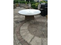 8 seater round patio table. Rattan style with glass top 150cm