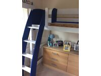 Bunk bed with separate matching chair that doubles as a pull out bed