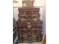 vintage leather and canvas suitcases