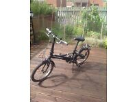 Folding bike in excellent condition. With carrying bag