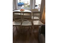 4 Glossy white wooden dining chairs
