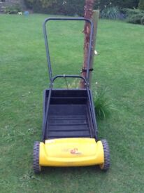 Hand lawn mower complete with grass collecting box.