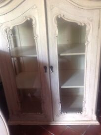 Beautiful cream woodfrench armoire. Comes in two pieces. Cupboard with doors fits on top ofdrawers