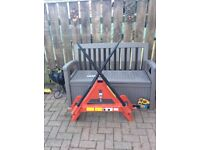 Tractor three point link folding bale spike