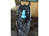 Quinny black pushchair with cosy toes and raincover suitable from 6 months
