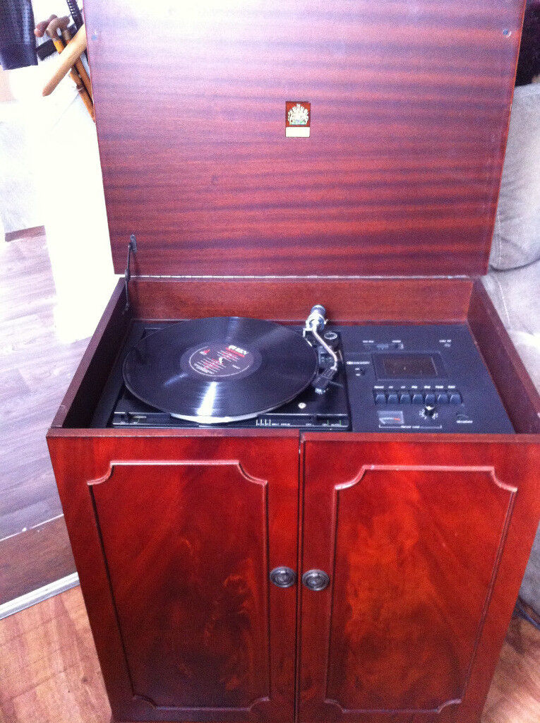 DYNATRON MUSIC CENTER IN MOHOGANY CABINET. RECORD PLAYER AND RADIO FINE but tape deck sticks