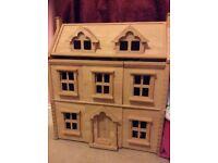 Wooden dolls house - plan toys