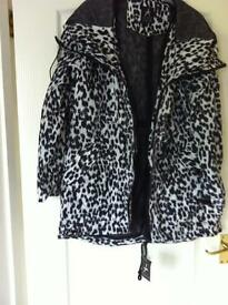 Brand new with tags animal print fold up shower coat size 12 bought in euros