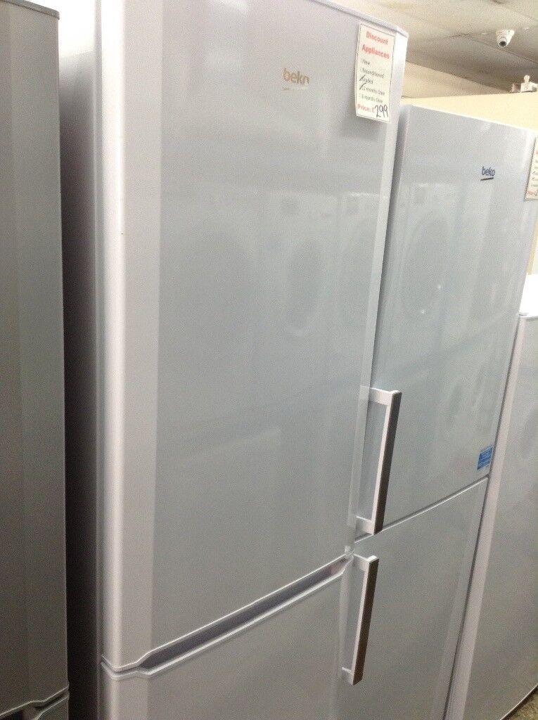 Beko tall White fridge freezer. £299. New/graded 12 month Gtee