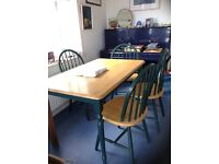 Quality Pine oblong kitchen table and 4 matching chairs
