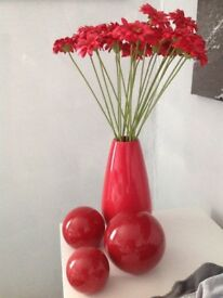 Red vase , with flowers & 3 red ball ornaments ( next )